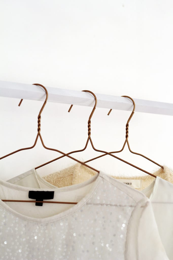 Copper-Hangers-three-with-garments-portrait1-682x1024