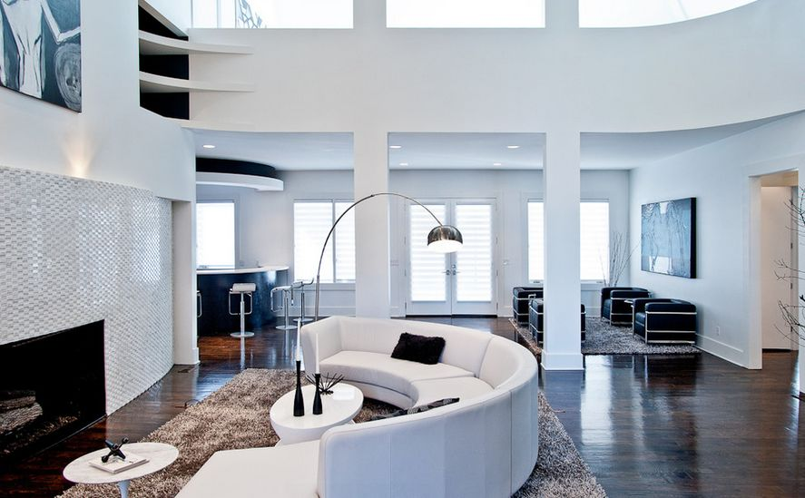 contemporary-black-white-living-room-high-ceilings-and-curved-sofa
