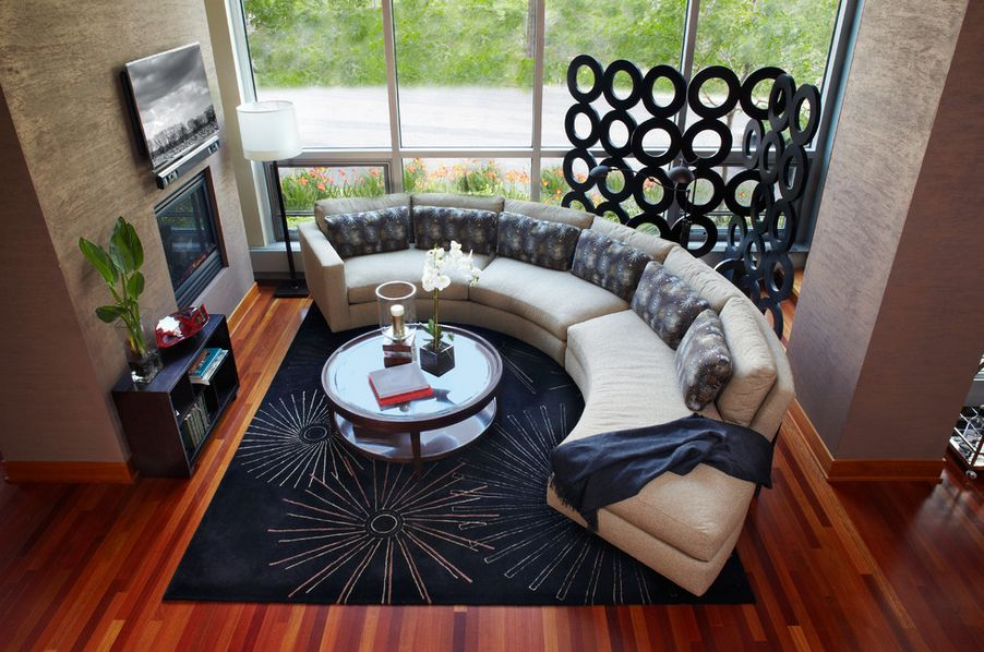 curved-sofa-around-the-tv-fireplace