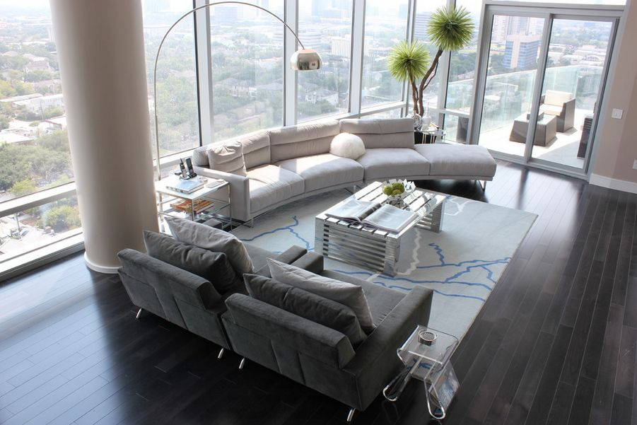 modern-living-room-high-ceiling-with-big-views-and-curved-sofa