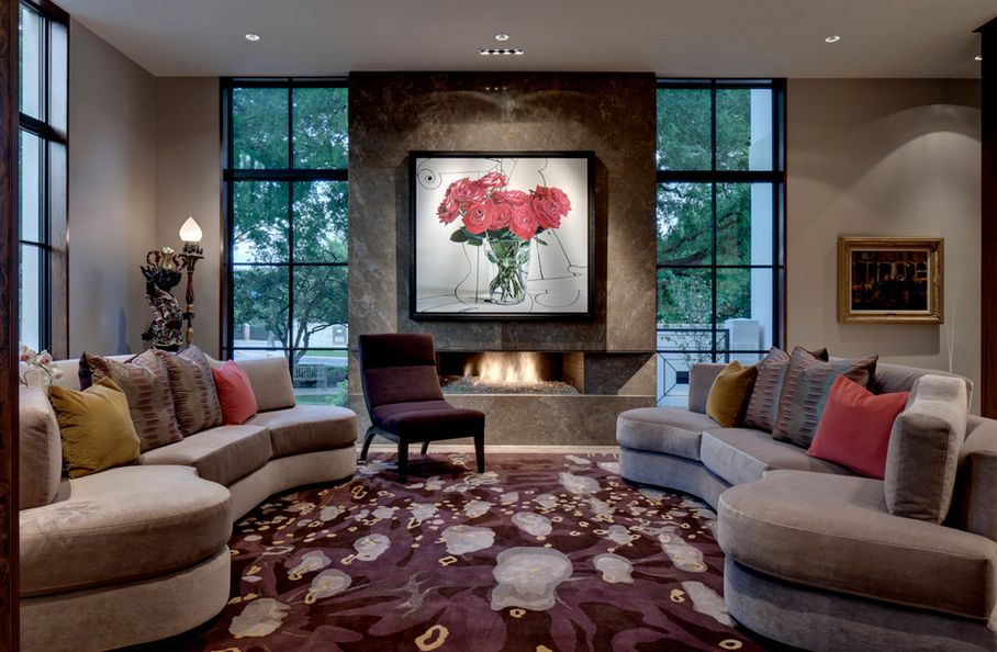 texas-living-room-fireplace-with-roses-wall-art-above-and-bold-cherry-carpet