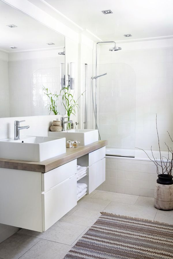 white-bathroom-bit-warm-decor-add-a-carpet