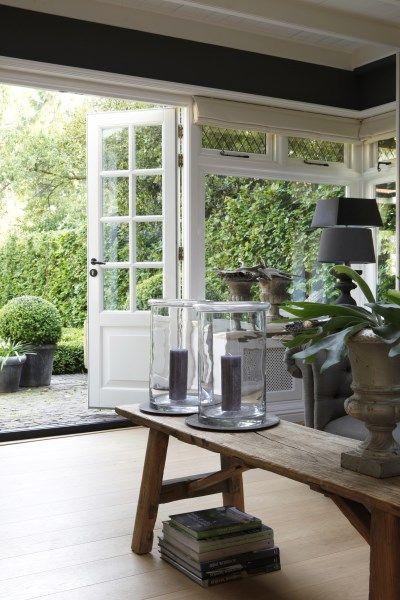 Schuifdeuren naar tuin — InteriorInsider.nl