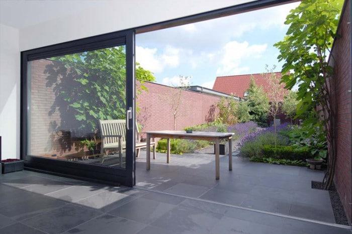 Betrek je tuin bij je woonkamer interieur insider - Gordijnen voor overdekt terras ...